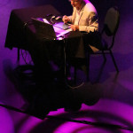 Artist Bill Russell digital drawing on stage at the Shell Theatre